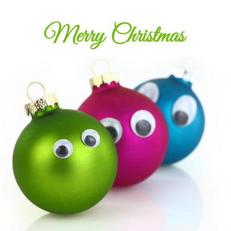 Cute Christmas balls with eyes isolated on white  photo