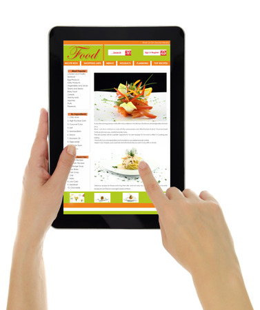 scrolling: Hands holding tablet with recipe website template isolated