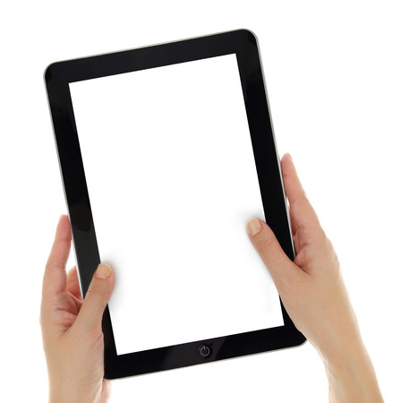 Female hands vertically holding tablet with blank screen isolated photo