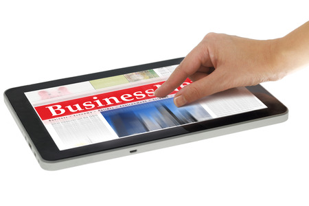 zooming: Hand zooming in digital news on tablet computer, isolated Stock Photo