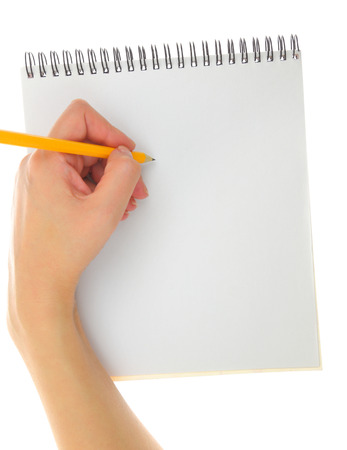 Hand drawing gesture with pencil and pad isolated photo