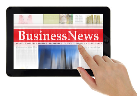 scrolling: Hand scrolling digital news on tablet computer Stock Photo