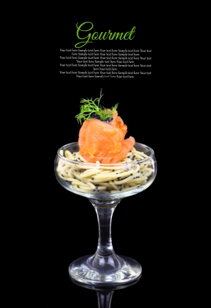 Smoked salmon with noodles and caviar, gourmet cuisine photo