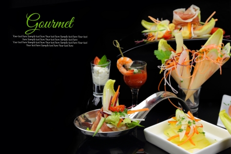 Various gourmet dishes with copy-space on black background photo