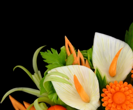 sculpting: Flowers carved from fruits and vegetables on black background Stock Photo