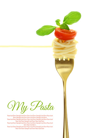spaghetti: Fork with spaghetti, tomato and basil isolated on white Stock Photo