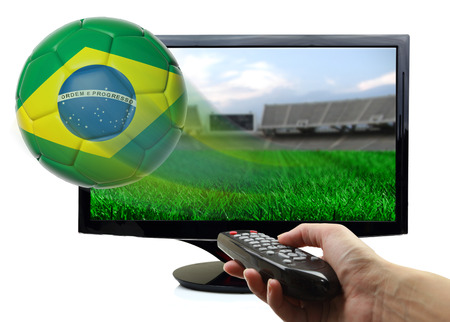 Soccer ball with Brazil flag flying off screen isolated photo