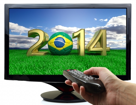 2014 and soccer ball with Brazil flag on tv photo