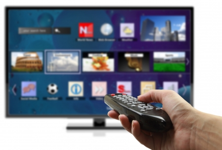 remote communication: 3D smart tv with hand holding remote control isolated  Stock Photo