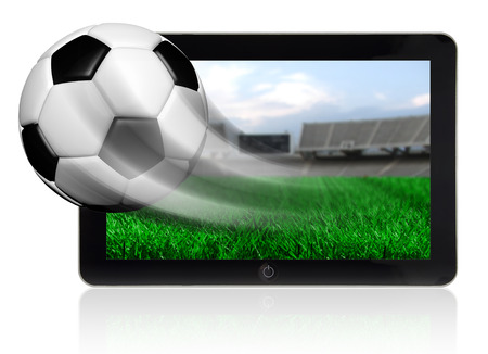 Soccer ball in motion flying off tablet screen isolated photo