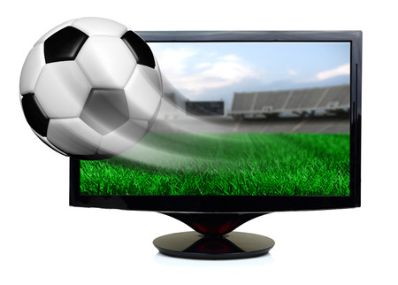 Soccer ball in motion flying off screen isolated photo