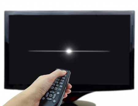 off: 3D black tv display with hand and remote control Stock Photo