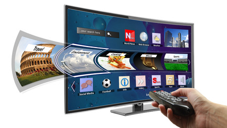 Smart tv with apps and hand holding remote control photo