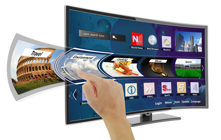Smart tv with apps and hand touching the screen photo