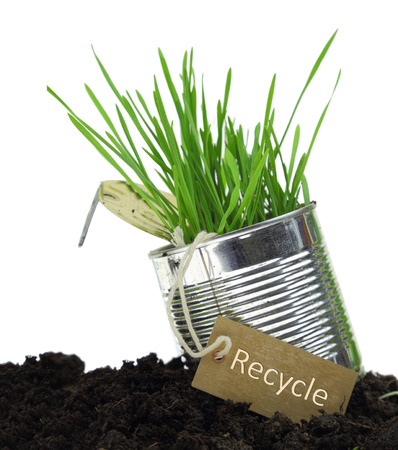 can food: Can with recycling tag and growing grass isolated