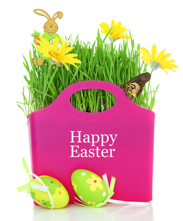 Bag with grass, flowers and Easter eggs isolated photo