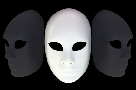 White mask with reflection on black background photo