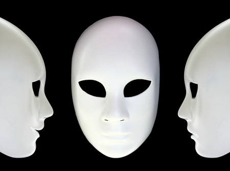 contrasts: White masks on black background Stock Photo