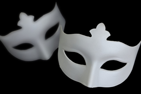 White mask on black background photo