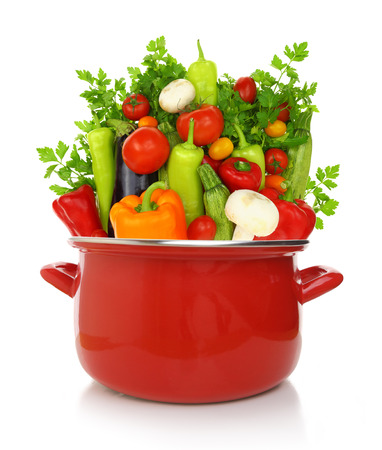 Colorful vegetables in a red cooking pot isolated on white background Stock Photo