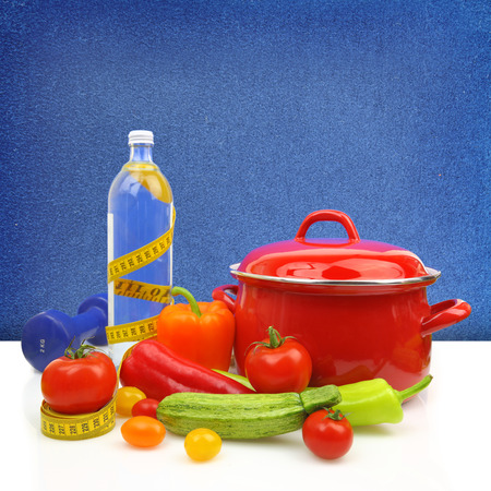 Diet concept with colorful vegetables and a red cooking pot  photo