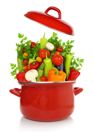 casserole: Colorful vegetables in a red cooking pot isolated on white background Stock Photo