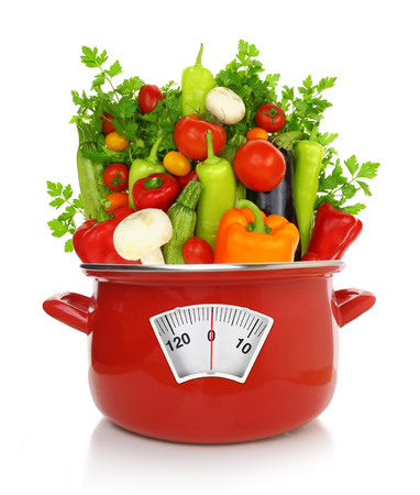 kilo: Diet concept. Colorful vegetables in a red cooking pot