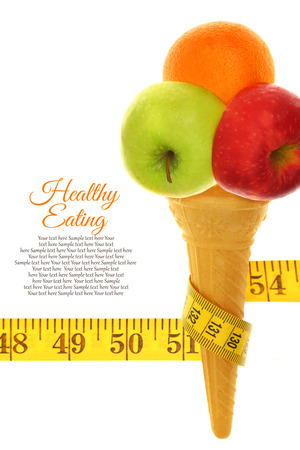Fresh fruits on ice cream cone with tape measure photo