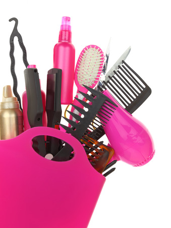 tool kit: Various hairstyling equipment in shopping bag isolated on white