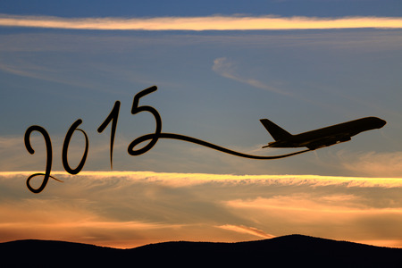 january sunrise: New year 2015 drawing by airplane on the air at sunset