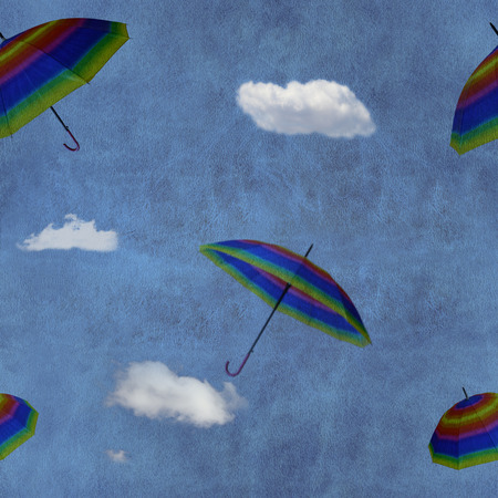 Flying colorful umbrellas on blue sky seamless pattern photo