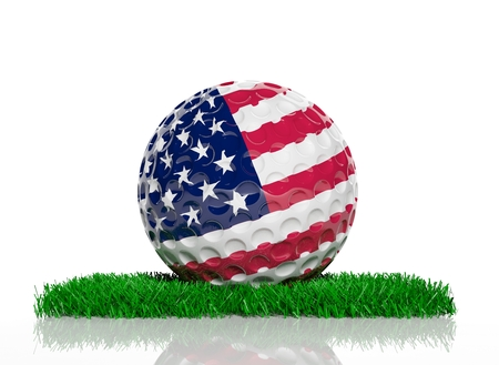 Golf ball with flag of USA on green grass  photo