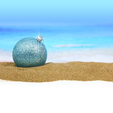 Christmas ball on the beach Stock Photo