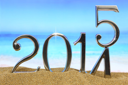 New year 2015 is coming on the beach photo