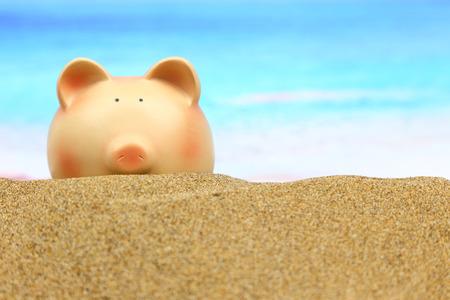 holiday profits: Summer piggy bank on the beach
