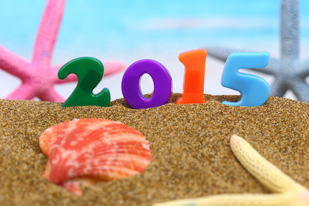 Multicolored new year 2015 on the beach photo