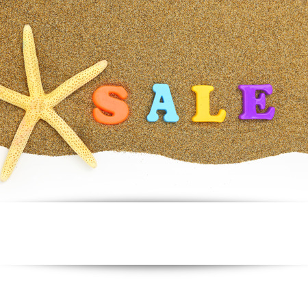 Sale text and starfish with banner on sand photo