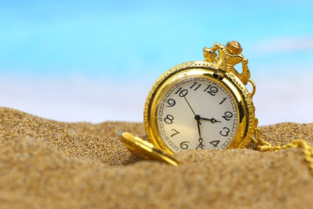 Pocket clock on the beach photo