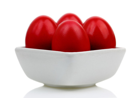 Red Easter eggs in a bowl
