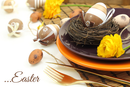Easter table setting with eggs and cutlery photo