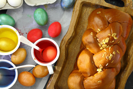 Easter sweet brioche, colored eggs and liquid dye photo