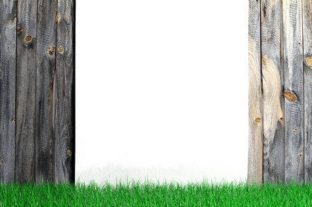 White blank frame with grass on wooden background photo