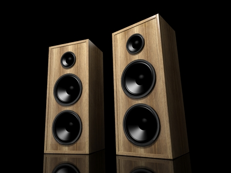 Two classic wooden speakers on black background with reflection photo