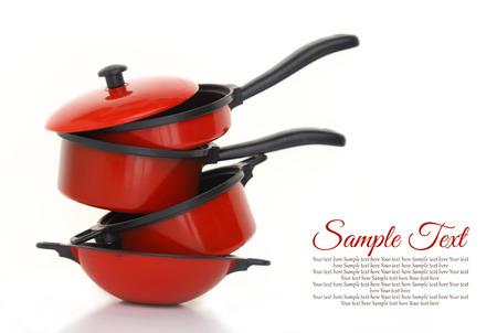 白い背景の設定赤調理器具 写真素材