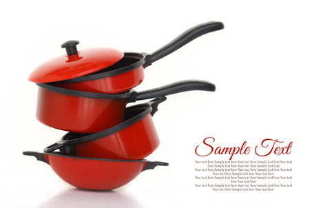 Red cookware set on white background Reklamní fotografie