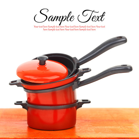 Red cookware set on white background photo