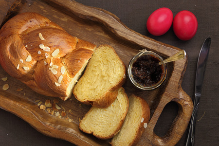 Easter sweet brioche on wooden tray  photo