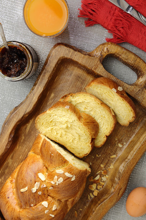 Sweet brioche bread on tray with juice and marmalade photo