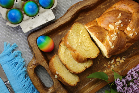 Easter sweet brioche and colored eggs photo