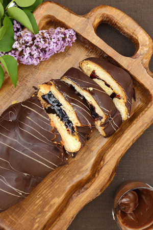 Sweet brioche bread with chocolate frosting and filling photo
